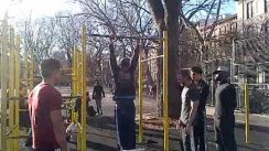 Zef doing muscle up with the pipe in front held with the feet!